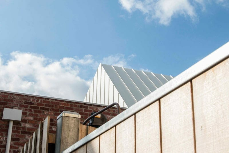 gable house features standing seam cladding by metal